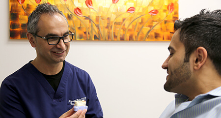Dr. Kar talking to male patient