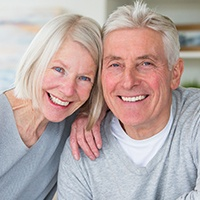 Smiling older man and woman