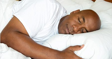 Man sleeping soundly in bed