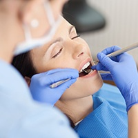 Relaxed woman receiging dental treatment