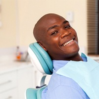 Dental patient smiling after undergoing treatment for a toothache