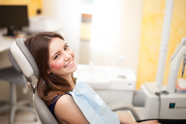 A woman visiting her family dentist in Allen.
