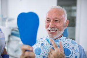 Dental patient smiling after replacing a metal crown